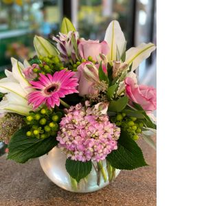 DiBella Flowers & Gifts Las Vegas - Perfect lavender roses, white lilies, green coffee bean, pink hydrangea and more in a clear bubble bowl. *Shade of Hydrangea may vary slightly