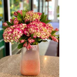 DiBella Flowers & Gifts Las Vegas - Brilliant pink hydrangeas and alstroemerias in keepsake pink vase.