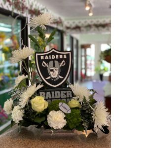 DiBella Flowers & Gifts Las Vegas - Keepsake raider figurines surrounded by fresh blooms. Go Vegas Raiders!
