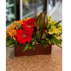 DiBella Flowers & Gifts Las Vegas - Bright blooms in keepsake bamboo vase.