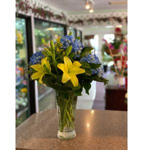 DiBella Flowers & Gifts Las Vegas - Blue hydrangea and yellow lilies. Perfect pair.