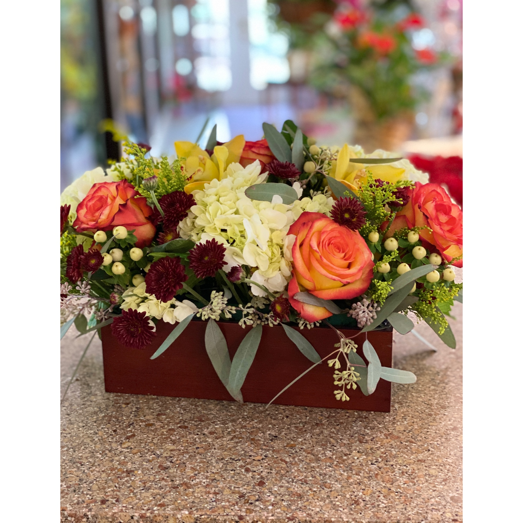 DiBella Flowers & Gifts Las Vegas - A gorgeous fall mix of roses, hydrangea, orchids and more in a dark bamboo base. Perfect for your holiday setting.