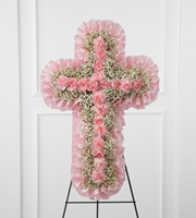 DiBella Flowers & Gifts Las Vegas - The FTD® Angel's Cross™ Easel is a graceful tribute to honor the life and faith of the deceased. Pink mini carnations and baby's breath are lovingly arranged in the shape of a cross, accented with a pink satin ribbon around the outside and displayed on a wire easel, to create a wonderful way to express your love for the departed.