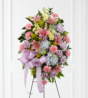 DiBella Flowers & Gifts Las Vegas - Blessings of the Earth Easel is a soft and serene arrangement that elegantly honors the life of the deceased. Lavender roses, pink carnations, pink Asiatic lilies, blue hydrangea, yellow stock, lavender button poms, solidago and lush greens are beautifully accented with a lavender satin ribbon and displayed on a wire easel to create a gorgeous display for their memorial service.