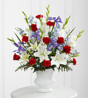 DiBella Flowers & Gifts Las Vegas - The FTD® Cherished Farewell™ Arrangement is an elegant display of patriotic beauty to honor your loved one at their final farewell service. Red roses, red carnations, white gladiolus, light blue delphinium, blue iris, white Oriental lilies, white Asiatic lilies and lush greens are elegantly arranged in a white plastic urn to create a stunning way to say your last goodbye.