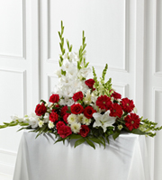 DiBella Flowers & Gifts Las Vegas - The FTD® Crimson & White™ Arrangement is a lovely symbol of peace and love. Red roses, carnations and gerbera daisies pop against the white blooms of gladiolus, snapdragons, Oriental lilies, and chrysanthemums. Accented with a variety of lush, vibrant greens, this exquisite arrangement is a beautiful tribute to the deceased.