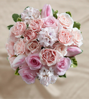 Dawn Rose Bouquet is a display of blushing sweetness full of feminine charm. Pink roses, tulips, spray roses and hyacinth (seasonally available) are brought together to form a bouquet that is both eye-catching and elegant tied together with a pink satin ribbon for a complete look.