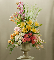 DiBella Flowers & Gifts Las Vegas - The FTD® Declaration™ Altar Arrangement blooms with the colors of happiness and grace to celebrate your wedding day. Peach tulips, peach roses, white roses, peach stock, dark pink dahlias, white delphiniums, pink spray roses, peach Asiatic Lilies, pink flowering branches and an assortment of fresh, lush greens are beautifully arranged in a resin urn and displayed on a 3 foot pedestal to brighten the altar during your ceremony.