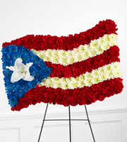 DiBella Flowers & Gifts Las Vegas - The FTD® Devotion™ Flag Tribute is an arrangement that commemorates the life of the deceased with patriotic beauty. Red carnations, white chrysanthemums, blue dyed chrysanthemums and a single white Oriental Lily are brought together to form the likeness of the Puerto Rican flag, offering a symbol of honor and devotion at their memorial service. Displayed on a wire easel.