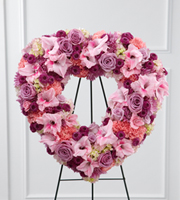 DiBella Flowers & Gifts Las Vegas - Eternal Rest Standing Heart bursts with love and sweet comfort to honor the deceased at their final farewell service. Lavender roses, pink carnations, purple button poms, lavender chrysanthemums, pink gladiolus and pink hydrangea are beautifully arranged in a the shape of a heart and displayed on a wire easel to create a stunning display of warm affection that will last in the hearts of friends and family for years to come.