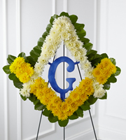 DiBella Flowers & Gifts Las Vegas - The FTD® Fond Reflections™ Tribute is a lovely way to commemorate the life of the deceased. Arranged in the symbol of Freemasonry are white and yellow chrysanthemums and lush greens accented with a Styrofoam® Masonic Blue Lodge Emblem, and a royal blue ribbon, to symbolize the devotion of the departed to his lodge at the final farewell service. Displayed on a wire easel.