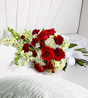DiBella Flowers & Gifts Las Vegas - The Forever in Our Hearts Casket Adornment is a beautiful accent piece that adds that extra touch of elegance to their final farewell service. Red roses and mini carnations are eye-catching and bright arranged amongst white hydrangea, larkspur, snapdragons and Queen Anne's Lace. Tied together with a white grosgrain ribbon, this gorgeous bouquet is a lovely way to say goodbye to your beloved.