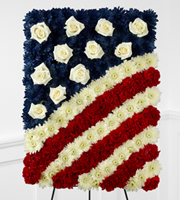 DiBella Flowers & Gifts Las Vegas - The FTD® Glory Be™ Flag Tribute is a symbol of patriotic beauty to commemorate the life of your loved one at their final farewell service. Red carnations, white chrysanthemums and blue dyed white chrysanthemums create a stirring arrangement in the likeness of the American flag with white rose accents to symbolize the stars. Displayed on a wire easel, this exquisite arrangement will bring comfort and peace to their family and friends.