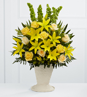 DiBella Flowers & Gifts Las Vegas - The FTD® Golden Memories™ Arrangement bursts with sunlit beauty to honor the life of the deceased. Brilliant yellow Asiatic lilies, roses and solidago are offset by cream roses, Bells of Ireland, teepee palm fronds and lush greens to create a dazzling display. Arranged in a large papier mache urn, this incredible presentation of floral grace will bring a cheerful elegance to their final farewell service.