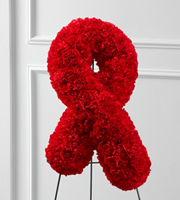 DiBella Flowers & Gifts Las Vegas - The FTD® Heartfelt™ Ribbon Easel is a beautiful, vibrant symbol of the ongoing fight against heart disease to be displayed at their final farewell service. Red carnations are elegantly shaped into the shape of a ribbon to create a presentation of hope during this time of grief and loss. Displayed on a wire easel.