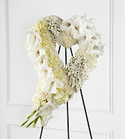 DiBella Flowers & Gifts Las Vegas - The FTD® Hearts Eternal™ Easel is an exquisite way to show your love and affection for the deceased. White gladiolus, hydrangea, statice, mini carnations and carnations are beautifully arranged into the shape of a heart and displayed on a wire easel to offer elegant sophistication at their final farewell service.