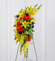 DiBella Flowers & Gifts Las Vegas - The FTD® Heaven's Light™ Standing Spray is a bright and brilliant tribute that offers warmth and hope. Sunny yellow gladiolus and Asiatic lilies are offset by crème de la crème roses, orange gerbera daisies, purple lisianthus, green button poms and lush greens. Accented with a designer sea mist green wired taffeta ribbon and displayed on a wire easel, this beautiful standing spray will be a ray of light to honor the deceased and bring comfort to friends and family.