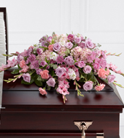 DiBella Flowers & Gifts Las Vegas - Immorata Casket Spray offers soft beauty and blushing comfort to honor the life of the deceased. Lavender roses, chrysanthemums and parrot tulips are elegantly arranged amongst pink carnations, gladiolus, stock, hydrangea and lush greens to create a presentation, intended to bedeck the top of the casket, that evokes sweet memories of your loved one for their final farewell service.