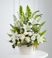 DiBella Flowers & Gifts Las Vegas - The FTD® In Our Thoughts™ Arrangement is a symbol of pure peace and caring kindness. White roses, tulips, freesia, Oriental lilies, double lisianthus, monte casino asters, and snapdragons, are beautifully offset by bright green Bells of Ireland, ivy vines, and an assortment of lush greens to create an elegant display that conveys your deepest sympathies for their loss. Arrives in a large round whitewash basket.