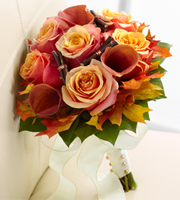 Love Everlasting Bouquet is a warm and inviting bouquet to give you the perfect wedding look. Gorgeous Cherry Brandy Roses display their unmatched beauty while mingling with mango mini calla lilies and fresh, lush greens. Accented throughout with preserved oak leaves and copper metallic wire and then tied together at the stems with a dramatic ivory French taffeta ribbon, this arrangement is sure to capture everyone's eye on this most momentous day.