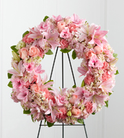 DiBella Flowers & Gifts Las Vegas - The Loving Remembrance Wreath is a blushing display of grace and beauty to honor the life of the deceased at their final tribute. Pink roses, Oriental lilies, gladiolus, hydrangea and carnations are brought together with lush greens to form the shape of a wreath, offering warmth and comfort with its sweetly sophisticated elegance. Displayed on a wire easel.