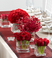 DiBella Flowers & Gifts Las Vegas - The FTD® Modern Grace™ Centerpiece consists of five individual bouquets to create one exceptional look. Clear glass cube vases in varying heights each carry a bouquet of one of the following flowers, including, red roses, bi-colored red and white roses, red tulips, red mokara orchids, and red carnations to give your head table a look of elegant distinction.