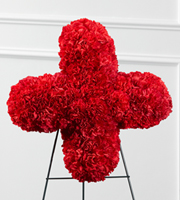 DiBella Flowers & Gifts Las Vegas - The FTD® Our Hearts Speak to You™ Red Cross is a beautiful addition to their final farewell service. Rich red carnations are brought together to form the Red Cross symbol, displaying the departed's devotion to the cause or commemorating how the Red Cross helped them in their time of need. Displayed on a wire easel