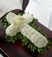 DiBella Flowers & Gifts Las Vegas - The FTD® Peaceful Memories™ Casket Spray is a gorgeous way to commemorate the faith and devotion of the deceased. White carnations are arranged in the shape of a cross accented in the middle with white roses and spray roses and along the sides with lush greens to create a lovely casket spray that brings peace and solace to those that attend their final farewell.