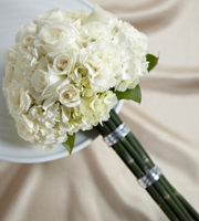 Perfect Love Bouquet is a soft display of bridal elegance that will complete your overall look. White roses, spray roses, carnations and hydrangea are accented with lush greens and arranged in a rounded compact style to offer texture and interest with its natural grace and beauty. *Equisetum stems seasonally available - natural bamboo sticks or flower stems may need to be substituted.