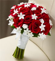 DiBella Flowers & Gifts Las Vegas - (Seasonal) Poetry Bouquet has a look of pure elegance and charm that will make you look your bridal best. Red roses are accented with white tulips and white stephanotis blooms beautifully tied together with a white French taffeta ribbon to give you an appearance that only poetry could describe.  *Stephanotis blooms are seasonally available. Please call for availability.