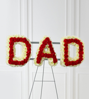 "DiBella Flowers & Gifts Las Vegas - The FTD® Remembering Dad™ Arrangement is the perfect way to commemorate your father at his final farewell service.  White chrysanthemums and red mini carnations are beautifully arranged to form the word, ""Dad,"" to create a wonderful way to express the love you have for the man that gave you so much throughout the years. Displayed on a wire easel."