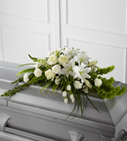 DiBella Flowers & Gifts Las Vegas - The FTD® Resurrection™ Casket Spray inspires thoughts of comfort and peace to those wishing to pay their respects for the loss of the deceased. White tulips, roses, snapdragons, Oriental lilies, larkspur, carnations and monte casino asters are accented by the bright green stems of Bells of Ireland and an assortment of the finest lush greens to create the perfect arrangement to display on the top of their casket during their final farewell service.