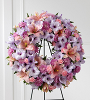 DiBella Flowers & Gifts Las Vegas - Sleep in Peace Wreath is a soft expression of sympathy that will bring comfort and offer hope during the final farewell. Lavender gladiolus, pink Asiatic lilies, lavender chrysanthemums, pink mini carnations and lush greens are beautifully arranged in the form of a wreath for a sweet and colorful look. Displayed on a wire easel, this wreath is a lovely way to honor the life of the deceased.