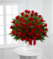 DiBella Flowers & Gifts Las Vegas - The Soul's Splendor Arrangement is a rich display of the love shared throughout the life of the deceased. Brilliant red roses are elegantly displayed in a white designer plastic urn and accented with lush greens and red satin ribbon to create a beautiful tribute to honor your special relationship.