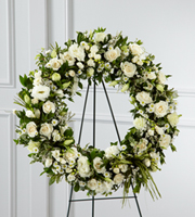 DiBella Flowers & Gifts Las Vegas - The FTD® Splendor™ Wreath is a symbol of lasting love and kinship, whether for the deceased or in comfort of those suffering from a loss. Elegant white freesia, double lisianthus, spray roses, monte casino asters and limonium are accented with a variety of lush greens and green raffia ribbon, perfectly arranged in the form of a wreath, to create a beautiful way to display your sincere sentiments.