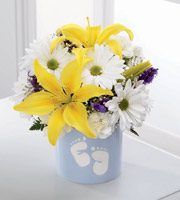 Send wishes of Sweet Dreams to the new baby boy. White daisy poms and mini carnations, purple statice and a yellow Asiatic lily fill a baby blue ceramic vase. Baby footprints adorn the vase, making it a sweet keepsake for the new parents.