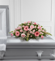 DiBella Flowers & Gifts Las Vegas - Sweet Farewell Casket Spray exudes an atmosphere of grace and soft serenity to commemorate a life lived with warmth and caring kindness. Blushing pink roses, gerbera daisies, spray roses, tulips and snapdragons are offset by a variety of lush greens and lovingly arranged to create a stunning accent piece intended to adorn the top of their casket at their memorial service.