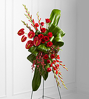 DiBella Flowers & Gifts Las Vegas - Sweet Thought Standing Spray is an expression of sophistication and beauty to commemorate the life of the deceased at their final memorial service. Brilliant red roses, gladiolus, anthurium, orchids and hypericum berries create an exquisite arrangement offset by bright green ti and aspidistra leaves folded in a unique pattern to create a presentation symbolizing the unending love you have for the departed. Displayed on a wire easel.