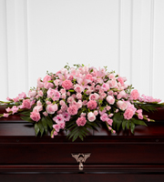 DiBella Flowers & Gifts Las Vegas - The Sweetly Rest Casket Spray is a wonderful way to commemorate a life abundant in beauty and love. Blushing pink roses, spray roses, carnations, gladiolus, mini carnations and Asiatic lilies are elegantly arranged amongst an assortment of lush greens to create a sophisticated display meant to bedeck the top of their casket at the final memorial service.