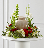 DiBella Flowers & Gifts Las Vegas - The Tears of Comfort Arrangement is an elegant and sophisticated way to surround their urn with floral beauty at the final farewell service. Rich red roses and spray roses are vivid and bright arranged amongst white tulips, larkspur, hydrangea, and trachelium, accented with the bright greens of Bells of Ireland, hypericum berries, ivy and myrtle, creating a wonderful way to honor the life of the deceased.