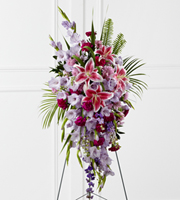 DiBella Flowers & Gifts Las Vegas - Tender Touch Standing Spray creates an elegant display of beauty and color to enhance their final tribute. Lavender gladiolus, Stargazer lilies, fuchsia carnations, purple larkspur, lavender Peruvian lilies, lavender chrysanthemums, sword fern fronds, emerald palm fronds and other assorted greens are gorgeously arranged to create a sophisticated standing spray. Displayed on a wire easel, this arrangement will add to the sophistication of their service with each fragrant bloom.
