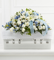 DiBella Flowers & Gifts Las Vegas - The FTD® Tender Treasure™ Casket Spray is a beautiful way to honor the life of the child taken too soon. White roses, daisies, monte casino asters, Asiatic lilies, and mini carnations are accented with light blue delphinium and a light blue organza ribbon to be displayed on top of the casket at their final farewell service.