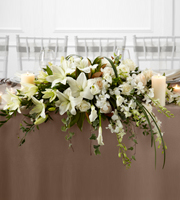 DiBella Flowers & Gifts Las Vegas - The FTD® White Linen™ Arrangement speaks to the true nature of wedding elegance. White Dendrobium Orchids, Asiatic Lilies, mini calla lilies, and roses are accented with an assortment of lush greens and arranged to add to the décor of the wedding party's table with its sweet sophistication.