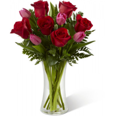 "The FTD Love Wonder Bouquet bursts with the beauty and magic of love's finest moments. Brilliant red roses are brought together with fuchsia tulips and lush greens in a classic clear glass vase to create a bouquet rich in romance and sweet sentiments. GOOD bouquet includes 10 stems. Approx. 15""H x 11""W. BETTER bouquet includes 13 stems. Approx. 16""H x 12""W. BEST bouquet includes 15 stems. Approx. 17""H x 13""W. <br>"
