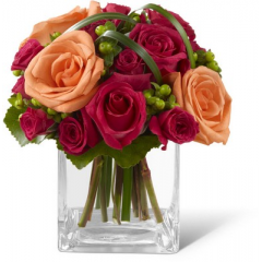 """The FTD Deep Emotions Rose Bouquet showers your special recipient with affection and admiration in sun-crushed hues. Deep fuchsia roses and spray roses share the spotlight with bright orange roses, green hypericum berries and lily grass blades gorgeously arranged in a clear glass vase. Fresh and eye-catching with extraordinary color, this bouquet will evoke warm feelings with its undeniable charm.   <br><br>Approximately 8""""H x 6""""W"""