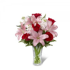 """The FTD Anniversary Bouquet is a gorgeous way to celebrate your sweet affection for the love of your life on your special day. Showcasing rich red roses, brilliant pink Asiatic lilies, pale pink stock and a variety of lush greens, this beautiful bouquet is presented in a clear designer cut glass vase for a classic look of sophistication and elegance. GOOD bouquet includes 10 stems. Approx. 15""""H x 13""""W. BETTER bouquet includes 13 stems. Approx. 16""""H x 14""""W. BEST bouquet includes 17 stems. Approx. 17""""H x 15""""W. <br>"""