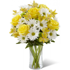 """The FTD Sunny Sentiments Bouquet is a blooming expression of charming cheer. Brilliant yellow roses and Peruvian Lilies are paired with white traditional daisies and green button poms to create a memorable bouquet. Accented with lush greens and arranged in a classic clear glass vase, this bouquet is a wonderful way to celebrate any of life's special moments. GOOD bouquet includes 12 stems. Approx. 16""""H x 12""""W. BETTER bouquet includes 17 stems. Approx. 17""""H x 13""""W. BEST bouquet includes 22 stems. Approx. 18""""H x 14""""W. <br>"""