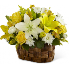 """The FTD Nature's Bounty Basket bursts with the beauty of floral brilliance. Yellow roses, Peruvian lilies, solidago and LA Hybrid lilies are arranged amongst white ranunculus, chrysanthemums and LA Hybrid lilies accented with lush greens for an eye-catching look. Presented in an oval banana leaf woven basket, this sunlit arrangement will warm your special recipient's heart with its blooming perfection. GOOD arrangement includes 13 stems. Approx. 12""""H x 16""""W. BETTER arrangement includes 19 stems. Approx. 13""""H x 18""""W. BEST arrangement includes 24 stems. Approx. 14""""H x 19""""W. <br>"""