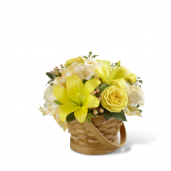"""The FTD Sunny Surprise Basket is the perfect way to delight your special recipient in honor of any of life's special occasions or for no special reason at all! Yellow roses, cream roses, yellow LA hybrid lilies, peach hypericum berries and lush greens are beautifully arranged in a woven woodchip handled basket to create an incredible gift intended to spread happiness with each sunlit bloom. GOOD basket includes 10 stems. Approx. 9""""H x 11""""W. BETTER basket includes 15 stems. Approx. 11""""H x 14""""W. BEST basket includes 19 stems. Approx. 12""""H x 15""""W. <br>"""