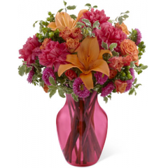 """The FTD All Is Bright Bouquet uses bold color to send smiles and cheer across the miles. Orange Asiatic lilies, fuchsia carnations, hot pink matsumoto asters, orange spray roses, green hypericum berries and lush greens are beautifully arranged to create a fantastic bouquet presented in a deep pink glass vase set to brighten your special recipient's day with each vibrant bloom. GOOD bouquet includes 13 stems. Approx. 14""""H x 12""""W. BETTER bouquet includes 17 stems. Approx. 15""""H x 12""""W. BEST bouquet includes 22 stems. Approx. 16""""H x 14""""W. <br>"""